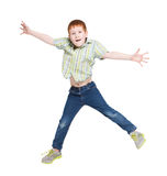 Happy laughing boy jumping on white isolated background Stock Photography