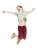 Happy laughing boy jumping on white isolated background Royalty Free Stock Photo