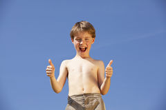 Happy and laughing boy posing thumbs up Stock Photography