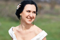 The happy laughing bride with flowers in hair Royalty Free Stock Photography