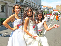 Happy, laughing Brides after the traditional Street Race in Belg Royalty Free Stock Image