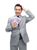 Happy laughing businessman with euro money Stock Photo