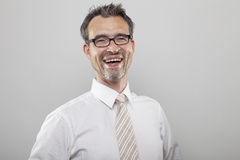 Happy laughing businessman. Man in formal wear with tie happily smiles royalty free stock photos