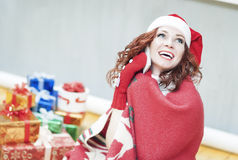 Happy and Laughing Caucasian Santa Girl with Lots of Presents Be Stock Photo