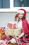 Happy and Laughing Caucasian Santa Girl with Lots of Presents Be Royalty Free Stock Images