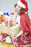 Happy and Laughing Caucasian Santa Girl with Lots of Presents Be Stock Images