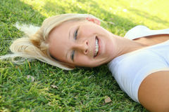 Happy Laughing Caucasian Woman Relax On Grass Stock Photos