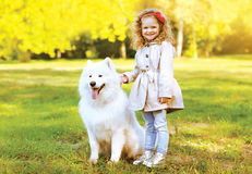 Happy laughing child and dog having fun outdoors Royalty Free Stock Images