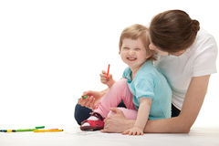 Happy laughing child drawing with her mother Stock Photography