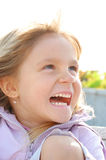 Happy laughing child face Stock Photos