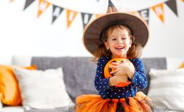 Happy   child girl in witch costume to halloween Royalty Free Stock Photos
