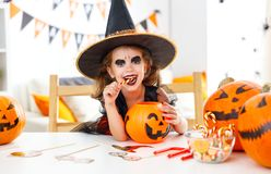 Happy   child girl in witch costume to halloween Royalty Free Stock Images