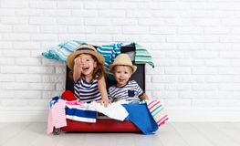 Happy laughing children  with suitcase going on a trip Royalty Free Stock Photo