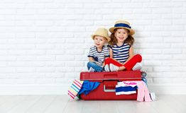 Happy laughing children  with suitcase going on a trip Royalty Free Stock Images