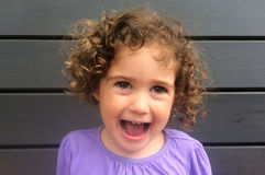 Happy and laughing curly child girl Stock Photo
