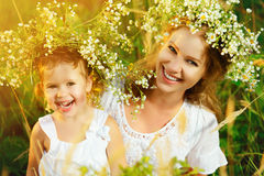 Happy Laughing Daughter Hugging Mother In Wreaths Of Summer Flow Royalty Free Stock Image