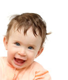 Happy laughing dishevelled baby Stock Image
