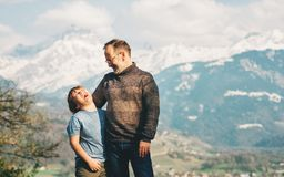 Happy laughing father and son hiking in mountains. Active family time. Image taken in Valais, Switzerland stock photos