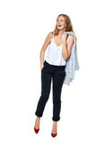 Happy laughing female. In full length looking to the side at blank copy space, over white background Stock Image