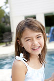 Happy laughing girl in backyard Stock Photography