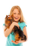 Happy laughing girl holding little dog Royalty Free Stock Image