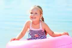 Happy laughing girl and swim ring Royalty Free Stock Images