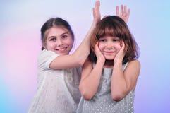 Happy laughing girls talking and having fun Royalty Free Stock Photo