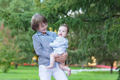 Happy laughing kids, brother and sister in a park. On a summer day royalty free stock photos