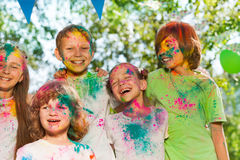Happy laughing kids smeared with colored powder Royalty Free Stock Photography