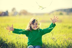 Happy laughing little girl with hands in the air royalty free stock photography