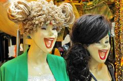 Happy laughing mannequins. Asian and caucasian Royalty Free Stock Photography