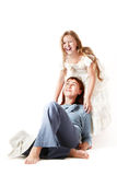 Happy laughing mother and daughter. Mother and daughter. Happy laughing woman and girl isolated on a white background Royalty Free Stock Image