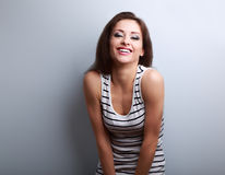 Happy laughing natural emotion young woman looking on blue backg Stock Photos