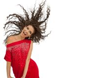 Happy laughing playful woman posing in red dress Royalty Free Stock Photo