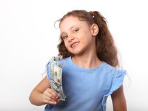 Happy laughing rich kid girl holding money hand on white backgro. Und with empty copy space Royalty Free Stock Images