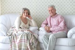 Happy laughing senior couple at home. Close-up portrait of a happy laughing senior couple at home royalty free stock photo