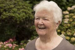 Happy laughing senior woman outdoors. With copy space royalty free stock images