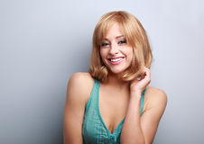 Happy laughing short hair blond woman. Bright makeup and hair st Stock Photography
