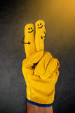 Happy Laughing Smileys on Fingers of Protective Gloves Royalty Free Stock Images