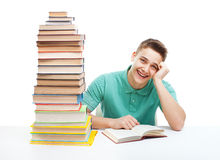 Happy laughing student studying Royalty Free Stock Image