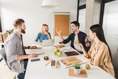 Happy laughing team in office Stock Photos