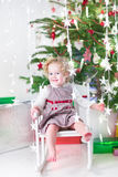 Happy laughing toddler girl with Christmas lights Royalty Free Stock Photos