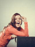 Happy laughing woman girl sitting at home. Royalty Free Stock Photo