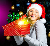 Happy laughing woman  holds the christmas box with gifts Stock Photography