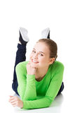 Happy laughing woman lying on her belly Stock Photography