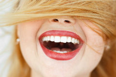 Happy laughing woman with red hair close-up. Portrait of unrecognizable carroty girl with wide perfect smile. Fun, gladness, joy concept Stock Image