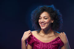 Happy laughing woman in sequined dress royalty free stock photography