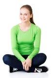 Happy laughing woman sitting cross-legged Royalty Free Stock Photo