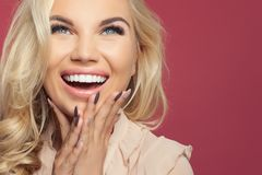 Happy laughing woman, young face closeup. Excited girl on colorful background with copy space royalty free stock photo