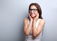 Happy laughing young casual woman holding hands the face Stock Image